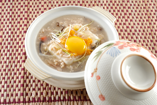 A photo of egg yolks in a Chinese soup.